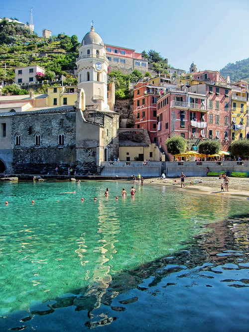 Enjoy a beautiful day at Italy's Cinque Terre, a seaside area composed of 5 villages, all with great views, food and paths to wander down.