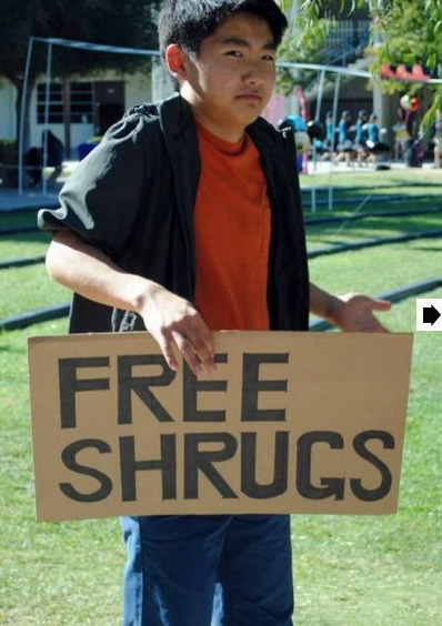 Free Shrugs A little more apathetic than the Free Hugs guy.