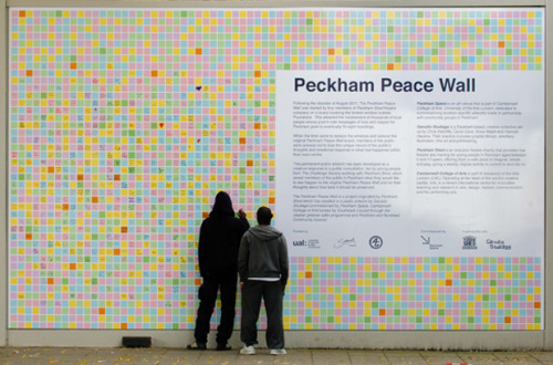 "Peckham Peace Wall by Garudio Studiage ""The Peckham Peace Wall is a permanent memorial to the hearty spirit of local residents who spontaneously contributed to a wall of Post-it note messages after last summer's riots"" During the riots that occurred only 12 months ago, residents in Peckham began sticking Post-it notes on windows that were boarded up to show their love and respect for the community that was now in tatters. This permanent installation features 4,000 of those original notes that have been digitised and arranged over a three wall spread. Limited edition prints have been produced to fund local art clubs, and can be purchased from here.  Artists: 