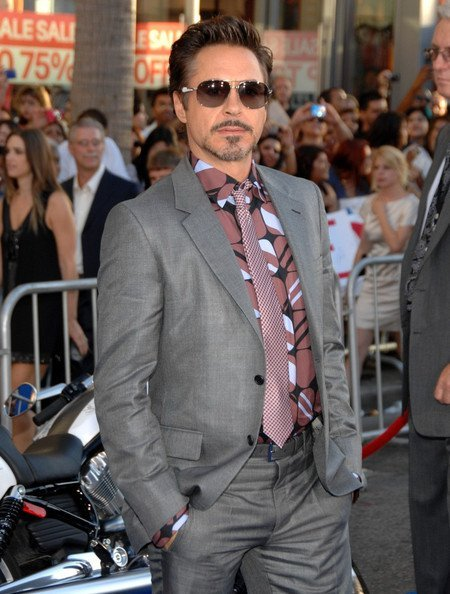 ROBERT. I will grant you the grey suit (with matching belt!) and the sunglasses but. what is that hideous shirt. the pattern itself is admittedly NOT HORRIBLE, but it is the kind of pattern that belongs on an ACCENT PILLOW adorning a black futon in a tiny pseudo-minimalist apartment.  NOT ON THE BODY OF A MOVIE STAR. and you have only exacerbated things by wearing with it that hideous patterned tie, which IN NO WAY GOES WITH THAT SHIRT AT ALL.  wrong color, wrong pattern, wrong everything. robert. i am beginning to suspect you are patternblind in addition to colorblind, because otherwise there is no excuse for this monstrosity.