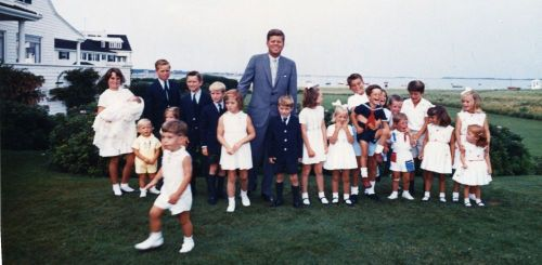 JFK poses with a much younger generation of Kennedys.