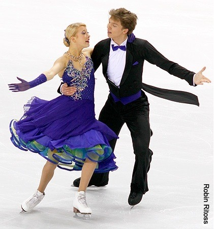 Ekaterina Bobrova and Dmitri Soloviev performing the Golden Waltz compulsory dance at the 2010 World Championships. I like the peacock-esque colour scheme a lot.