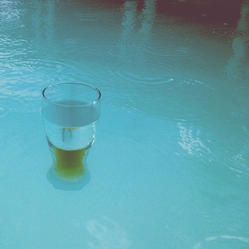 thedeadline:  Beer. In the pool. In the rain. (Taken with Instagram)