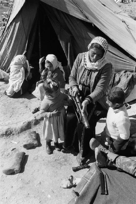 Jordan. Near Amman. 1969. Palestinian woman and children in refugee camp of Baka.