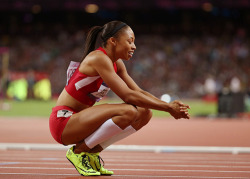 theolympics:  Allyson Felix smiles at the conclusion of the women's 200 meter final, in which she placed first, winning the gold medal.