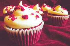 God Save→Red Velvet Cupcake A red velvet cupcake is a popular cake with a dark red, bright red or red-brown color. It is usually topped with cream cheese icing. The reddish color is achieved by adding red food coloring.