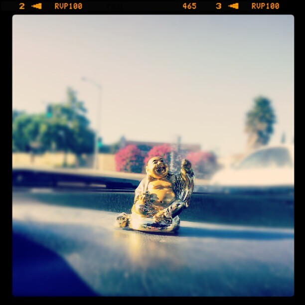 @heyitsokayy has a mini #Buddha on his car's dashboard. Oh, dear. (Taken with Instagram)