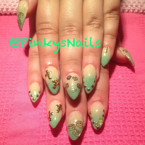 Seafoam ombré stiletto tips blinged out with gold on sweetheart @nancyfett by Jen ! (Taken with Instagram at Pinky's Nails)