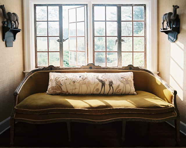Natural light, fresh air, body pillow a.k.a. cuddle buddy, and an olive green velvet couch just waiting to be napped on? Where do I sign up?