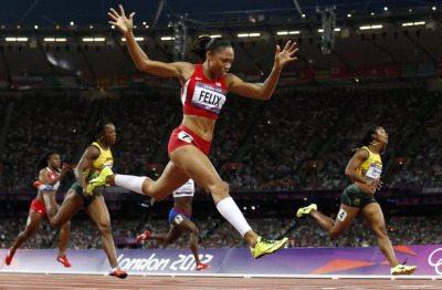 Allyson Felix, a two-time Olympic runner-up in the 200 meters, finally claimed gold. The Southern California native finished her specialty race in 21.88 seconds Wednesday night, while Jamaica's Shelly-Ann Fraser-Pryce took the silver and Carmelita Jeter of the U.S. claimed the bronze.