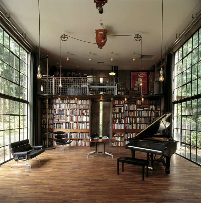 This is the PERFECT space. I'm drooling. Where do I even begin?! The bookshelves, the piano (I need to learn how to play), the wood floors, the open windows, the hanging light bulbs, the leather couch and chairs, the two floors, and lastly, the pole that you can shimmy down from the top floor to the bottom floor. A part of the room I am not likely to grow out of. Adorable, sophisticated, and classic. Love.