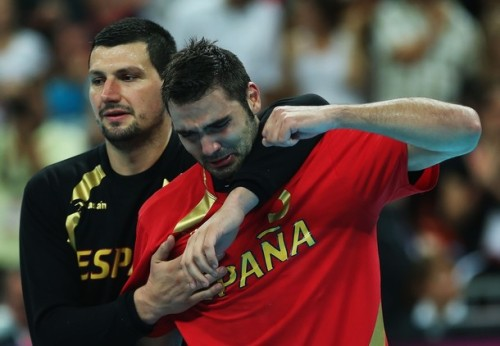 Spain Handball player grieving his side loss.