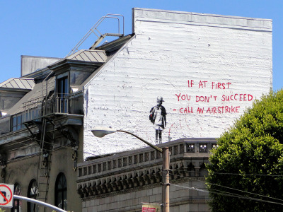 If at first you don't succeed - call an airstrike. Banksy. Broadway @Columbus in San Francisco, CA.