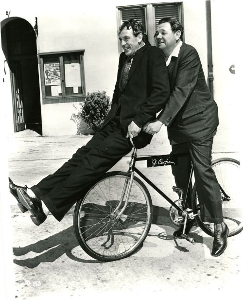 Gary Cooper and Babe Ruth ride a bike.