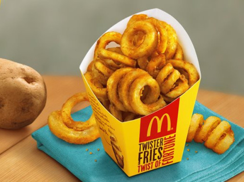 Wait what? McDonald's serves curly fries in the Philippines? I know that McDonald's restaurants around the world have localized menus, but curly fries are UNIVERSAL. And even in the Philippines, the curly fries only show up for three weeks a year. What the hell McDonald's? You want me to beg? Via