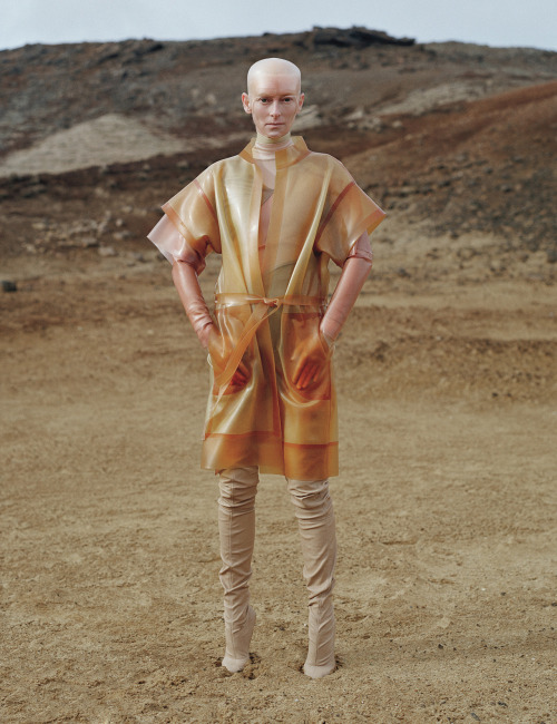 Tilda Swinton in latex coat and dress by VPL and boots by Maison Martin Margiela, photographed by Tim Walker for W August 2011.