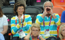 vegkat:  octowiggly:  The Swedish king and queen cheering for Sweden in last night's handball game. The lady in front just cracks me up.  This is one of the best pictures ever.  Everything about it is perfect.