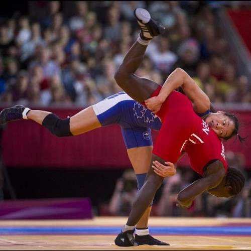 Canada's Carol Huynh (blue) defeats Senegal's Isabelle Sambou (red) to win the bronze medal in the women's freestyle 48 kg category at the 2012 Summer Olympics in London, England, Wednesday August 8, 2012. (Kevin Van Paassen/The Globe and Mail) #london2012 #olympics #soccer #canada #photojournalism  (Taken with Instagram)