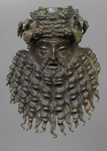 ancientpeoples:  Bacchic Mask Bronze Roman, 1st Century AD The ivy wreath is clearly visibly on the head complete with bunches of grapes. His long beard is beautifully rendered, fanning out in twisted corkscrews.