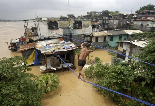Philippines begins clean-up after monsoon rains kill scores Reuters: The Philippines has started massive clean-up efforts after floods swept the capital and nearby provinces after nearly 2 weeks of monsoon rains killed 91 people.Power, water and communication services were restored as floodwaters started to recede. Disaster officials say nearly 300,000 people remain in temporary shelters. Photo: A resident traverses between 2 buildings on a rope in Psig City, east of Manila, Philippines on Aug. 9, 2012. (Francis R Malasig / EPA)