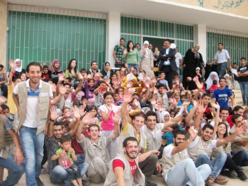 09/08/12 #Syria, Red Crescent members,volunteers and kids of our displaced families. Saluted all efforts that stand by our kids in such hard times.