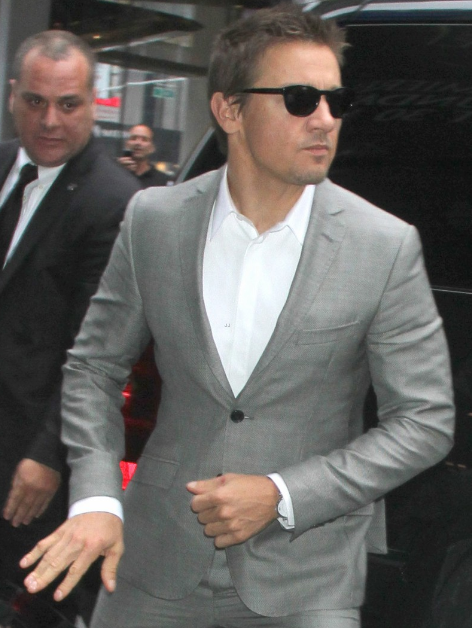 "Jeremy Renner was seen wearing a grey Etro suit on his way to a Good Morning America appearance to promote his film, ""The Bourne Legacy."" He also wore the suit for his appearance on Live with Kelly!"