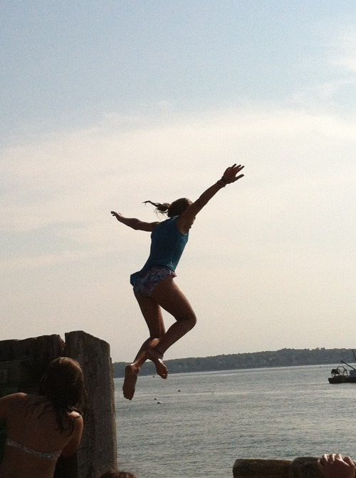 Jumping off the ferry landing on Peaks Island. Here's to savoring every weekend left in summer.