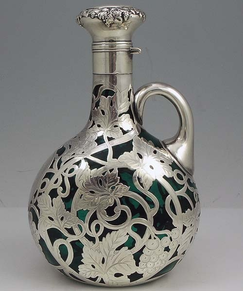 belaquadros:  An art nouveau silver overlay decanter by the Gorham Company in 1900 pinterest.com