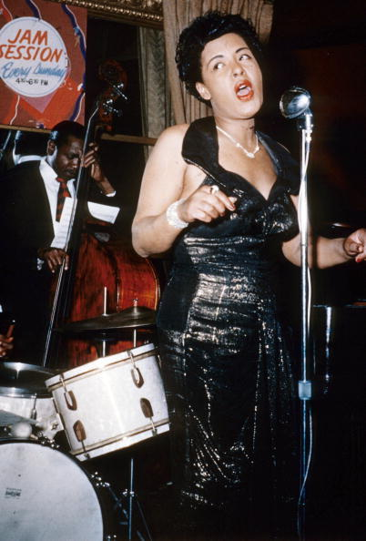 vintageblackglamour:  Billie Holiday on stage during a jam session in March 1954. Photo: Apic/Getty Images.