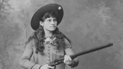 pbsthisdayinhistory:  August 13, 1860:  Sharpshooter Annie Oakley Born On this day in 1860, American exhibition shooter Annie Oakley was born in Ohio.  Annie's impeccable aim captured the attention of major figures worldwide, such as Queen Victoria of England and King Umberto I of Italy, for whom she performed while in Europe. One of Annie's most famous tricks was splitting a playing card with a .22 caliber rifle, edge-on, and putting several more holes in it before it could touch the ground at 90 feet away. Learn about Annie Oakley's lifelong adventures and travels with this timeline courtesy of American Experience.
