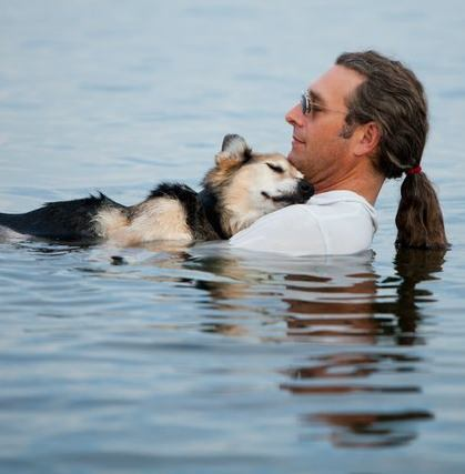 "One Man, One Dog, and the Facebook Photo That Touched Thousands of Hearts  Thursday, 9th August 2012  This is 19-year-old Schoep being cradled in his father's arms in the warm waters of Lake Superior. The arthritic dog falls asleep every night after he is carried into the lake where the buoyancy of the water soothes his aching body. The man's friend is professional photographer Hannah Stonehouse Hudson who took this photo during one of their therapeutic evening swims. She posted it on Facebook and it went wildly viral, with thousands of people sharing it and 28,294 comments (and counting). ""I was so happy I got to capture this moment for John,"" says the Bayfield, Wis., photographer. ""I have known them, for six years, and seen Schoep age."" ""John lives his life in a kind way. He rescued this dog as a puppy, they have gone everywhere together ever since."" Hannah specializes in relationship photos, like married couples and families — and pets with their owners. Visit her website, StonehousePhoto.com, or see her photos on Facebook: facebook.com/WisconsinWeddingPhotography. http://www.twincities.com/ci_21254327/photo-man-and-his-dog-lake-superior-goes"