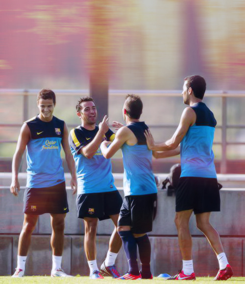 Why is Xavi always throwing the peace sign? Always directed at Villa too :)