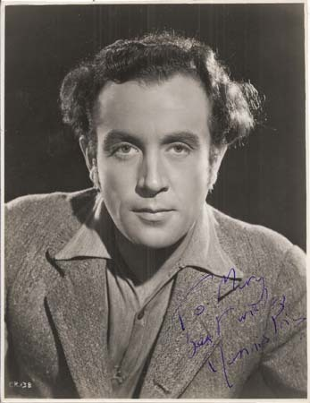 An autographed photo of Dennis Price, Louis Mazzini's alter ego.