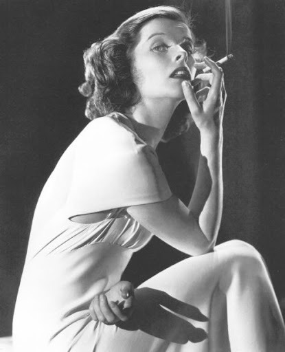 retrogasm:  Katherine Hepburn smoking… and in a dress…