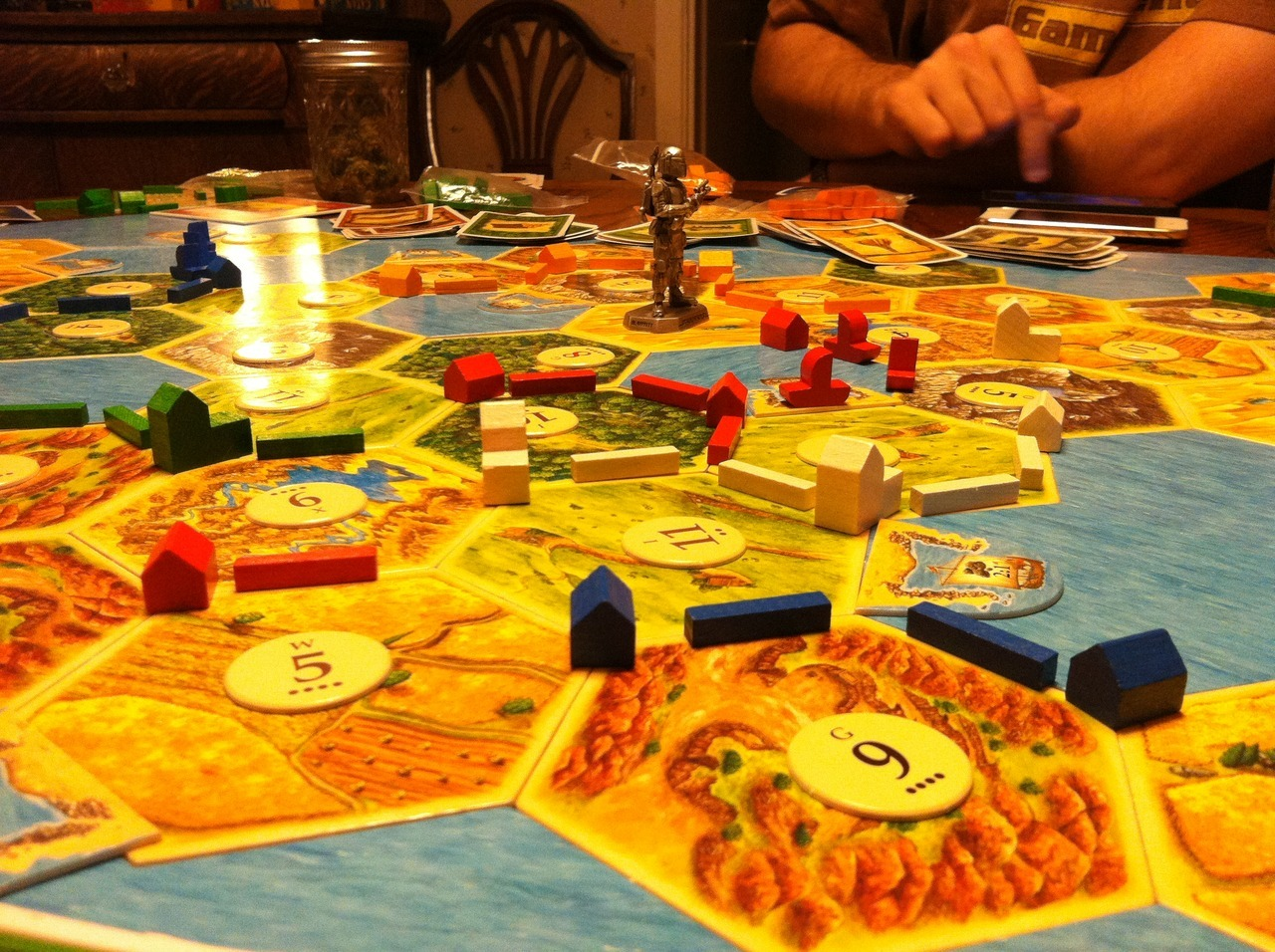 "seenontabletop:  Our group of friends has become pretty obsessed with Settlers of Catan. We've added both the Seafarers and the Cities and Knights expansion to our games and we've also started creating our own boards with variable setups. We love how customizable the game is with it's infinite variations. I'm also becoming pretty interested in the different ways that each ""civilization"" organically grows and the pictures they make!"