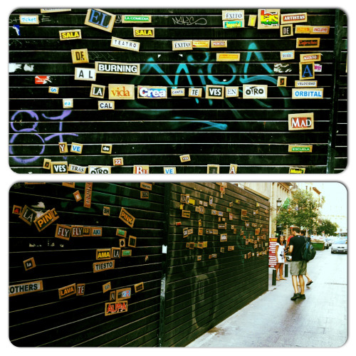 Madrid street art! Magnetic words placed on a construction barrier on calle principe. The streets are your canvas so paint away!