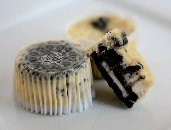 theyummyfood:  Oreo Cheesecake Cupcake Ingredients 30 Whole Oreo's and 12 Chopped Oreo's (I also added some extra crushed mini oreo's in the batter) 2 lbs Cream cheese = 4 (8oz) 1/3 reduced fat cream cheese 1 Cup Sugar 1 teaspoon vanilla extract 4 Large Eggs (beaten) 1 Cup light Sour Cream pinch of saltDirections Preheat the to 275 degrees Line a cupcake tin and place a whole Oreo in each cupcake liner. Beat the cream cheese in a electric mixer on medium high speed until smooth, gradually add your  sugar. Add the vanilla, mix until combined and slowly add the beaten eggs. Add your sour cream and salt beat until combined.  Stir in your crushed oreos. Fill your cupcake liner to almost the top. Bake for 22-25 minutes rotating the pan once half way through.  Cool on a wire rack and place in the fridge for 4 hours to set or over night.