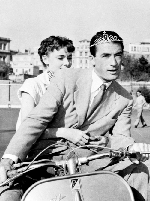 "famousmenwearingtiaras:  In the 1953 film Roman Holiday, rebellious teen Princess Gregory Peck is bored and takes a nameless peasant girl around for an awesome time in Rome because he feels like it, but it's only for a day because Princess Gregory Peck has other shit to do. Princess Gregory Peck did his own crazy scooter riding for the film. The girl in the film won an Oscar or something for being the peasant; said the coolly-jealous Princess Gregory Peck of the win, ""Yeah, well—you know."""