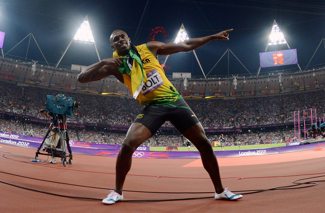 olympics:  Usain Bolt of Jamaica celebrates after winning gold in the Men's 200m Final.   Photo by Harry How/Getty Images