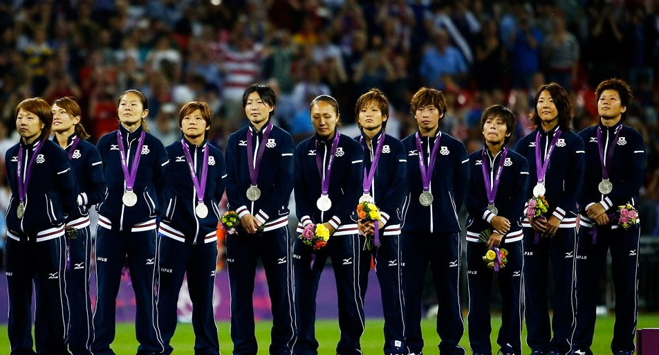 The Japan WNT celebrate their silver medal win [Photo Credit: Getty]