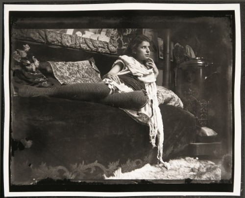 marydear:  Model reclining on the couch in Mucha's studio, Rue du Val-de-Grâce, Paris. (1899)