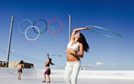 hoopingdotorg:  Shakti Sunfire holds a hula hoop class under the Olympic Rings at Squaw Valley in North Lake Tahoe, California, during the Wanderlust Festival. Lake Tahoe was site of the 1960 Winter Olympic Games. She lives in San Francisco, California, USA. Photo by Cadencia Photography. A Hooping.org Photo of the Day. http://www.hooping.org/2012/08/olympic-hoop-dance/