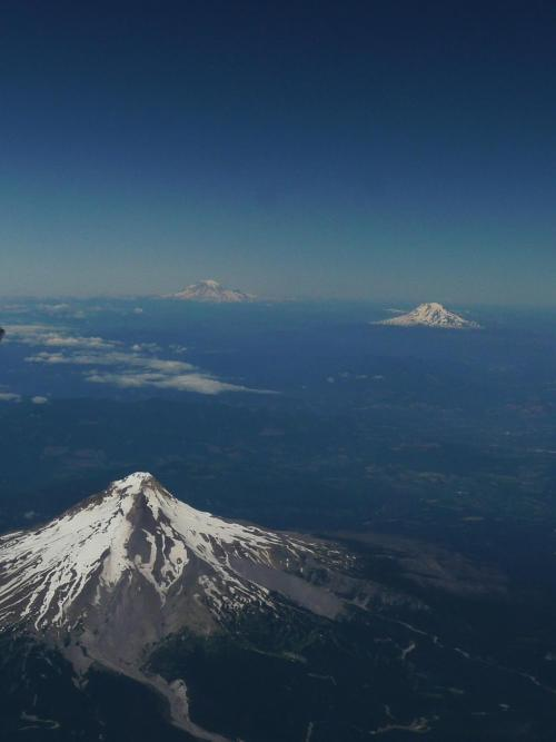 Mt. Hood, Rainier and St. Helens in one picture. - Imgur