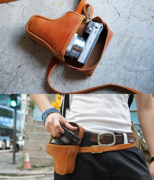 I need this. Photography never looked more badass. (via Fancy - Roberu Gun Holder Camera Case)