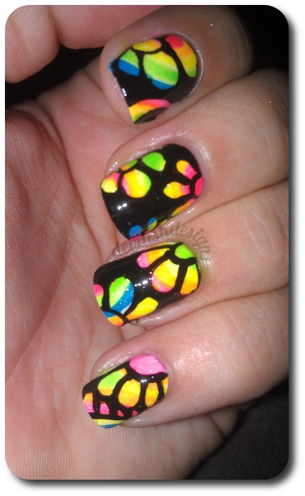 Todays mani is inspired by Robin Moses, you can find her tutorial here. Its fun and bright and different! I love it. This is two coats of Milani White On The Spot and the rest I really dont remember what colors I used lol a whole bunch of neon polishes and then one layer of Sinful Colors Smokin Hot for some sparkle and the black is acrylic paint topped with NYC& SHID. I hope yall enjoy this!! Have a great day.
