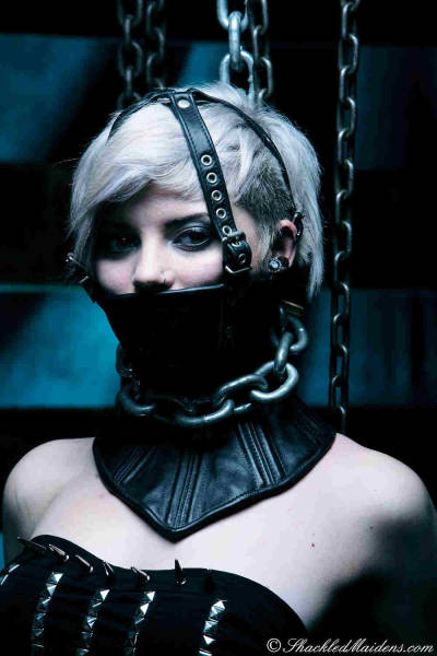 daddysfucktoys:  Dolly wearing a neck corset by Shackled Maidens (pics)