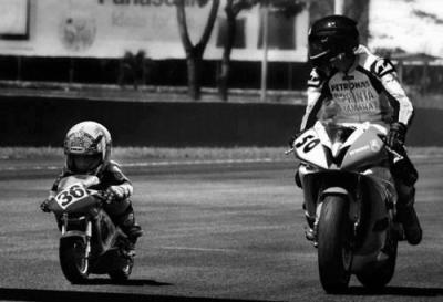 "Like father like son. ""Get it, boy!"" A mini race motorcycle. <3"