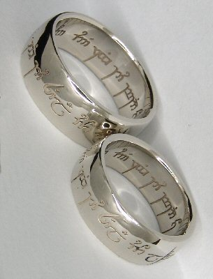 "aryssarynn:  Wedding rings! The elvish engraving says: ""One ring to show our love, one ring to bind us, one ring to seal our love and forever entwine us."" I'm geeking out so hard right now. THESE WILL BE MY WEDDING RINGS.   Surely wedding rings is plural and requires a minimum of two rings fucking stupid!"