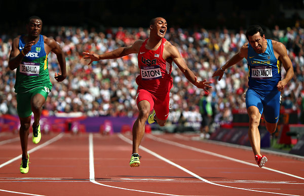 "inothernews:  U.S. athlete Ashton Eaton, seen here running the 100 meters, took gold in the decathlon today, completing all ten events and scoring 8,869 points — nearly 200 points ahead of American Trey Hardee, who took the silver.  From the New York Times:  Minutes before Eaton sat down at his news conference, the sprinter Usain Bolt, fresh off his latest 200-meter triumph, said he deserved that title. Someone asked Eaton the same question. He pursed his lips. Trey Hardee, a fellow American decathlete and former world champion, answered for him. ""So Ashton doesn't have to sound selfish or self-centered, Ashton is the best athlete on the planet, hands down,"" Hardee said. He cited the history of the decathlon, the way that title came about, how it was passed down over decades, from one decathlete to the next. Someone relayed Bolt's answer. Hardee's response came back quickly. ""Just because you're fast doesn't make you an athlete,"" he said.  (Photo: Jed Jacobsohn / The Times)"
