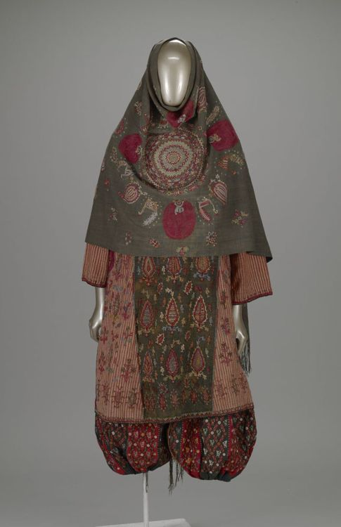 non-westernhistoricalfashion:  Woman's wrapper Culture: Zoroastrian people Creation date: about 1900 Materials: Silk on Cotton Gallery label: As soon as a Zoroastrian girl could sew, she would begin to embroider strips of brightly colored fabrics in order to have them ready for her wedding. Zoroastrianism is the ancient religion of Iran and it was the Persian Empire's state religion until the advent of Islam in the 7th century. The dress and the pants are composed  of a multitude of brightly colored fabrics. The lower part of the trousers is made of several colorful strips that are intricately embroidered with stylized plants, animals, fish, circles, stars, and diamonds.  Zoroastrianism is pretty dang interesting and this is really cool.